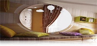 LED зеркало со светодиодной подсветкой овальное над кроватью в комнате